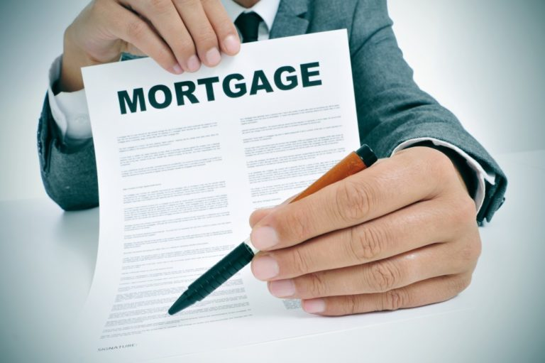 man showing a mortgage loan contract