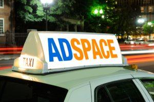 Taxi billboard close-up at night