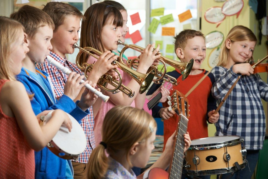 children playing different music instruments