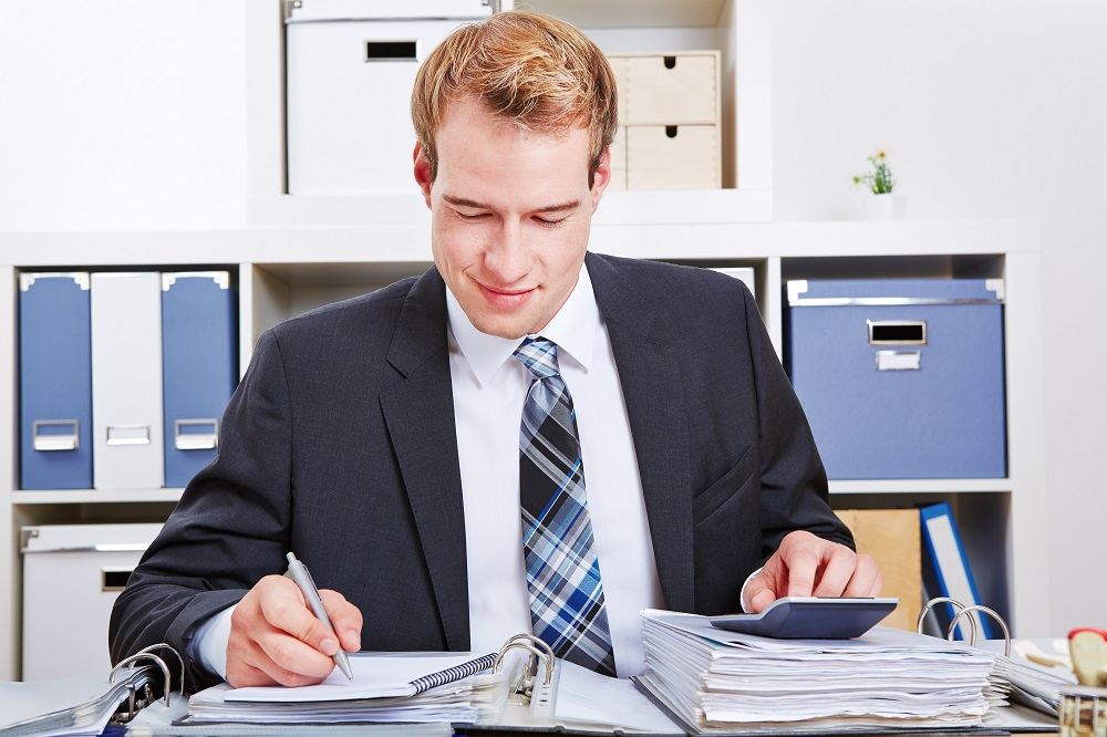 accountant writing a statement
