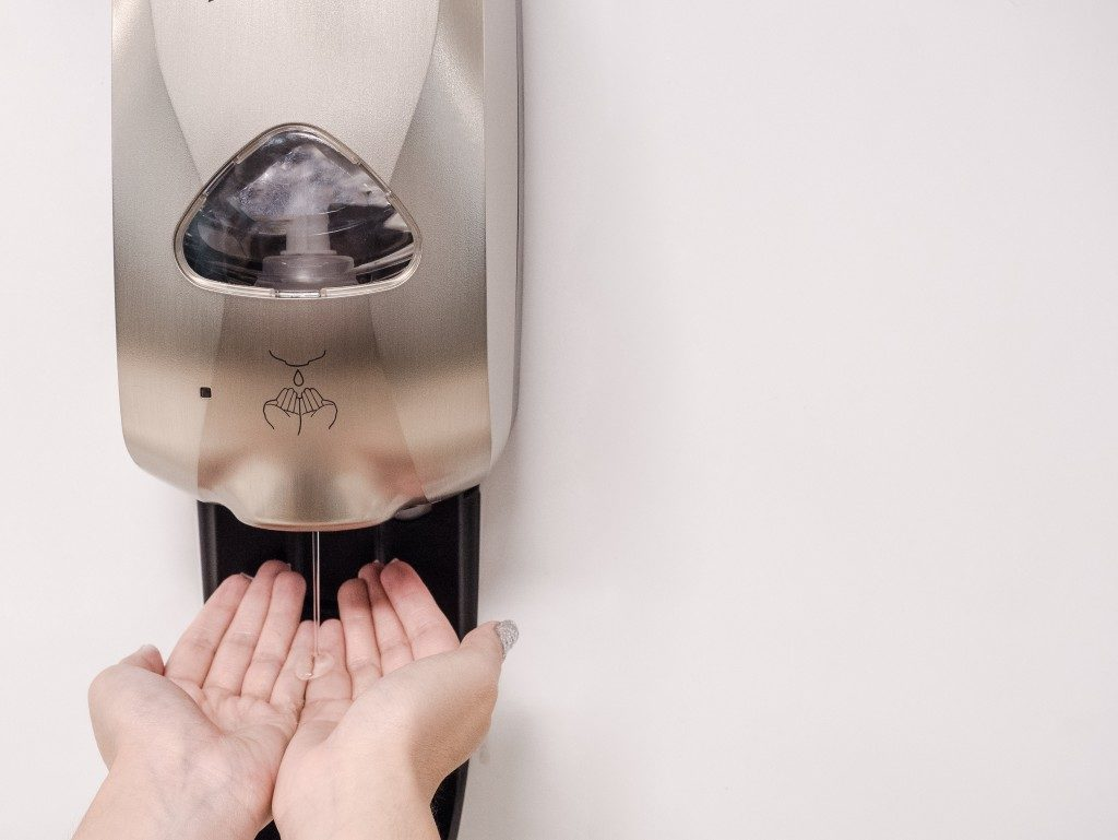 person getting hand sanitizer