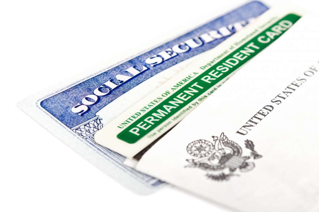 social security and green card on white background