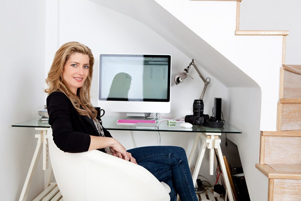 woman by her computer