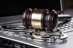 gavel and handcuffs on a keyboard