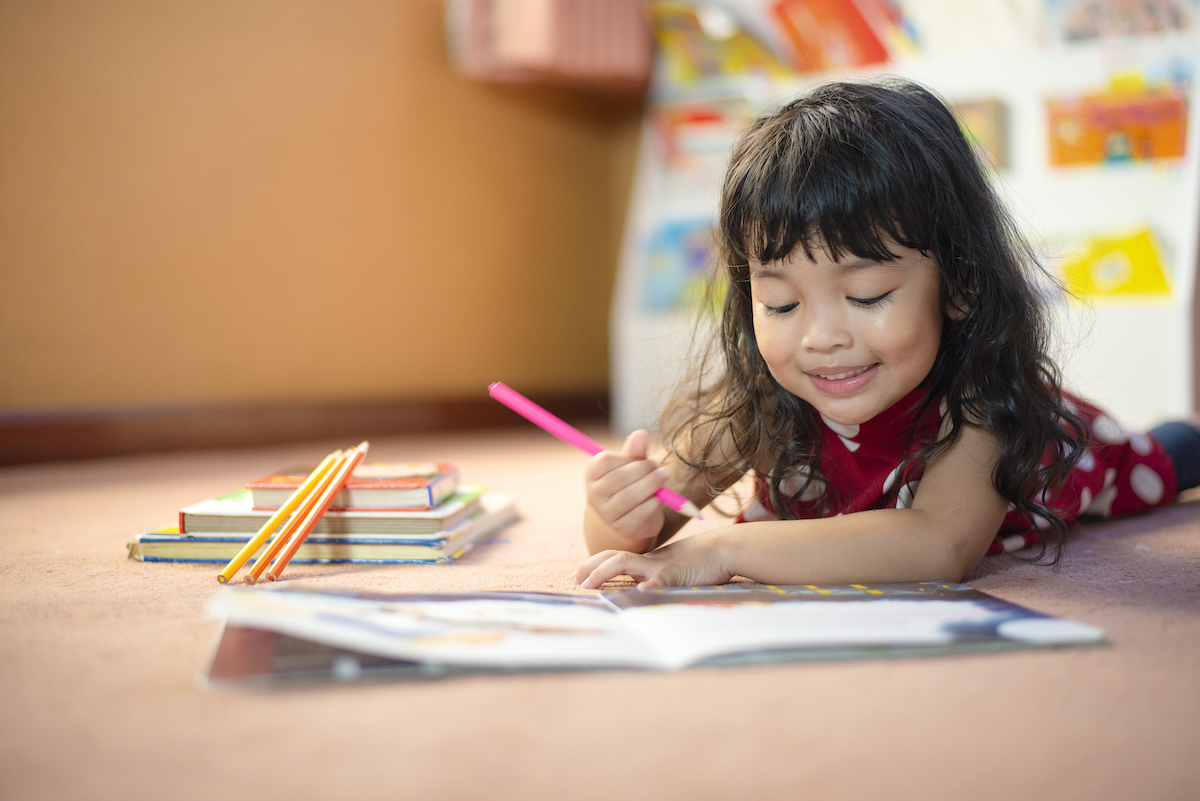 child working on an activity book