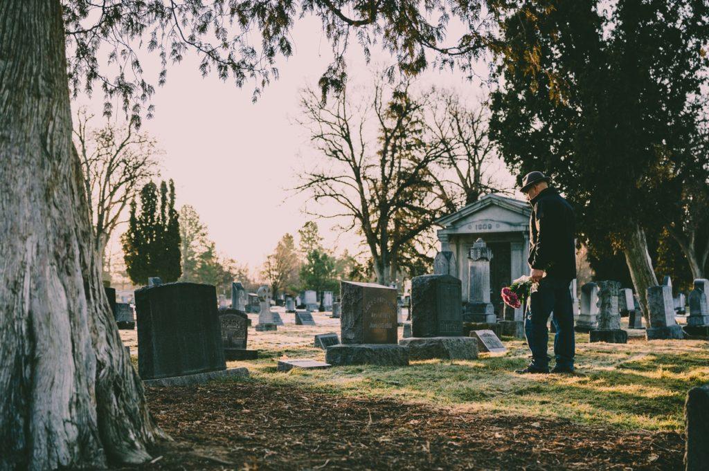 man at a graveyard