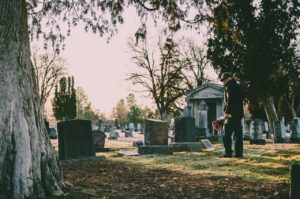 man at a graveyard