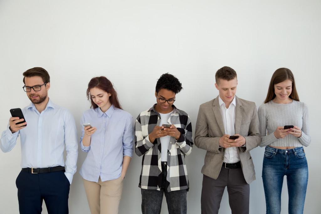 group of people using their phones