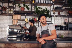 café owner smiling